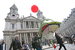 © licensed to London News Pictures. London, UK 01/05/2012. Protesters carrying a tent outside St Paul's Cathedral as Occupy London protesters gathering at Paternoster Square before their march for May Day in London. Photo credit: Tolga Akmen/LNP