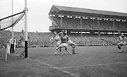 Cork player D. Bermingham tips ball over the bar for a point during the All Ireland Minor Gaelic Football final Cork V. Offaly in Croke Park on 27th September 1964.