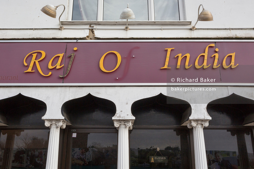 With the missing letter 'f', an exterior of the 'Raj of India', Indian restaurant, a fading exterior for eat-in or takeaway south-Asian foods in the suburban town of Swanley in south-east London, on 3rd February 2020, in Swanley, London, England.