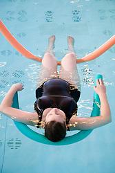 Pregnant woman taking part in an Aquanatal class,