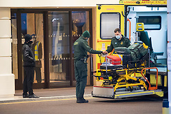 © Licensed to London News Pictures. 25/02/2021. London, UK. A ambulance arrives at the Radisson hotel near Heathrow Airport. New quarantine measures were introduced for travellers form red list countries, who are required to isolate for ten days in a hotel at a cost of £1,750 per person. Photo credit: Ben Cawthra/LNP