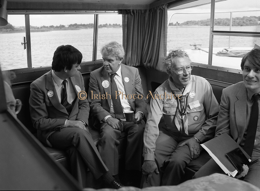 Irish Scout Jamboree .at Portumna Co Galway.1985..31.07.1985.07.31.1985.31st July 1985..The President Dr Patrick Hillery officially opened The Irish Scout Jamboree. The President,who arrived by helicoptor,was greeted by Camp Chief, Michael Webb, and a guard of honour of senior scouts. Amoung the invited guests from church and State was Mr Nicholas Scott,the Northern Ireland Office, Minister for Education..Ten thousand scouts took part in the jamboree. The Jamboree was a first in that for the first time the three scouting organisations within Ireland came together. The Scout Association of Ireland,The Catholic Boy Scouts of Ireland and The Northern Ireland Scout Council..Pictured among those relaxing aboard an Emerald Star Cruiser were Mr George Bermingham TD,Minister for Youth Affairs at the Dept of Labour,Mr Nicholas Scott,Northern Ireland Minister for Education and Mr Clifford Boyd,Chief Commissioner for Scouts,Northern Ireland.