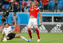 June 19, 2018 - Saint Petersburg, Russia - Artem Dzyuba (R) of Russia national team and Ahmed Fathi of Egypt national team look at the ball to enter the net during the 2018 FIFA World Cup Russia group A match between Russia and Egypt on June 19, 2018 at Saint Petersburg Stadium in Saint Petersburg, Russia. (Credit Image: © Mike Kireev/NurPhoto via ZUMA Press)