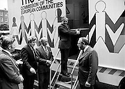 Commissioner Dick Burke cuts the ribbon to launch the EEC Roadshow, a mobile unit that toured the country. Among those in attendance are (l-r): Dr Garrett FitzGerald, TD, Leader of Fine Gael; An Taoiseach Jack Lynch and Frank Cluskey, TD, Leader of the Labour Party.<br />