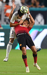 July 31, 2018 - Miami Gardens, Florida, U.S. - JESUS VALLEJO of Real Madrid pulls down ALEXIS SANCHEZ of Manchester United during a header attempt in the first half of International Champions Cup action. (Credit Image: © Jim Rassol/Sun-Sentinel via ZUMA Wire)