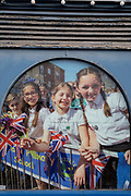Summer scenes in a cracked window of the 'Age Concern' charity, showing an event in the London suburb of Swanley in which Winter Olympic Skeleton medallist Lizzie Yarnold paraded her medal around Kent towns in 2018, on 3rd February 2020, in London, England