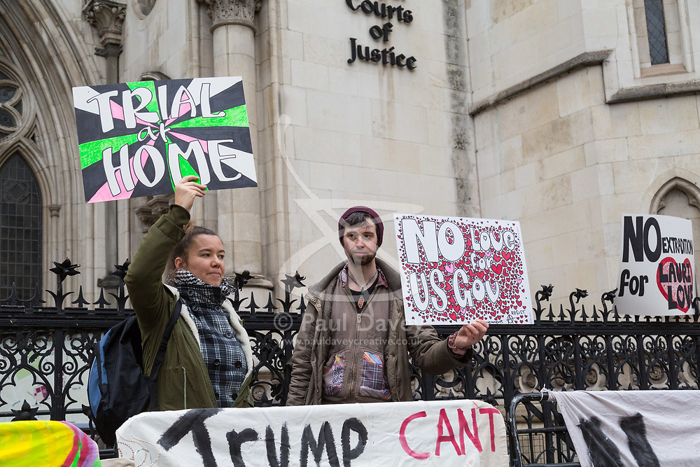 London - Alleged computer hacker Lauri Love arrives at the Royal Courts of Justice in London , pushing a mobile sound system playing electronic music, to find out whether he has successfully challenged a ruling that he can be extradited to the US, following allegations that he hacked United States government websites. PICTURED: Laurie Love 's supporters with their placards. February 05 2018.