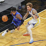 ORLANDO, FL - FEBRUARY 19:  Terrence Ross #31 of the Orlando Magic controls the ball in front of Kelly Oubre Jr. #12 of the Golden State Warriorsduring the first half at Amway Center on February 19, 2021 in Orlando, Florida. NOTE TO USER: User expressly acknowledges and agrees that, by downloading and or using this photograph, User is consenting to the terms and conditions of the Getty Images License Agreement. (Photo by Alex Menendez/Getty Images)*** Local Caption ***Terrence Ross;  Kelly Oubre Jr.