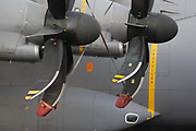 Propellers detail of an Airbus A400M military transporter plane exhibited at the Farnborough Air Show, England. The state-of-the-art propellers deliver huge amounts of aeronautical lift from this military plane. The Airbus A400M Atlas, is a multi-national four-engine turboprop military transport aircraft. It was designed by Airbus Military as a tactical airlifter with strategic capabilities. The aircraft's maiden flight, originally planned for 2008, took place on 11 December 2009 in Seville, Spain.