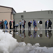 Supporters and potential caucus voters wait in line for a community event with Democratic presidential candidate Joe Biden at the Grass Wagon Event Center in Council Bluffs, Iowa on Wednesday, January 29, 2020.