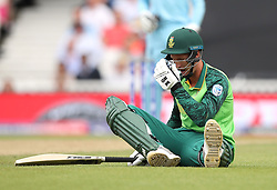 South Africa's Dwaine Pretorius on the floor after being run out by England's Ben Stokes (not pictured) during the ICC Cricket World Cup group stage match at The Oval, London.