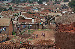 The neighborhood of Phiona Mutesi, a 14-year-old chess prodigy, in Kampala, Uganda,  Dec. 10, 2010. Mutesi days are spent in search of food, working at the market with her mother and dreaming of an escape from Katwe's slums. Although she is just now learning to read, her instincts have made her a player to watch in international chess. Mutesi, a naturally talented chess player is coached by Robert Katende of Sports Outreach Ministry. The chess club meets at the Agape Church inside Katwe, the largest of eight slums in Kampala.