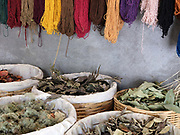 Naturally dyed woollen yarn and natural dye materials in the studio of master dyer Juana Gutierrez Contreras in the Zapotec village of Teotitlan del Valle, Oaxaca, Mexico on 1 December 2018. The natural dye materials are harvested in the Sierra Juarez mountains between October and November and other materials can be found in the courtyard gardens of Teotitlan. The plants are collected to make colourful dyes for blankets and other woven items