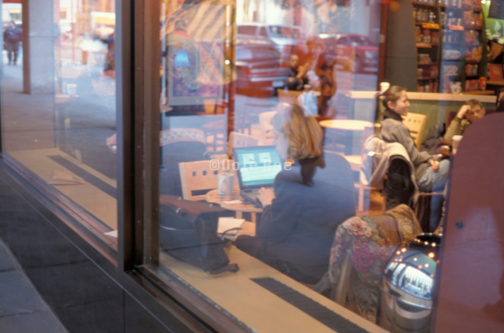seated women in cafe seen from outside through window