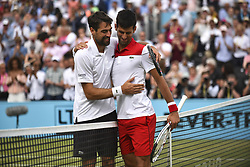 June 23, 2018 - London, England, United Kingdom - Novak Djokovic of Serbia (R) salutes Jeremy Chardy of France (L) after his victory against in the semi final singles match on day six of Fever Tree Championships at Queen's Club, London on June 23, 2018. (Credit Image: © Alberto Pezzali/NurPhoto via ZUMA Press)