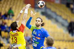 Filip Mirkulovski of F.Y.R. Macedonia and Dean Bombac of Slovenia during friendly handball match between National Teams of Slovenia and F.Y.R. of Macedonia before EHF EURO 2016 in Poland on January 5, 2016 in Arena Zlatorog, Celje, Slovenia. Photo by Urban Urbanc / Sportida