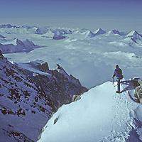 ANTARCTICA. Mountaineering. Mike McDowell (MR) atop 15,292' (4661m) Mount Shinn, third highest peak on continent. (Ellsworth Mountains)