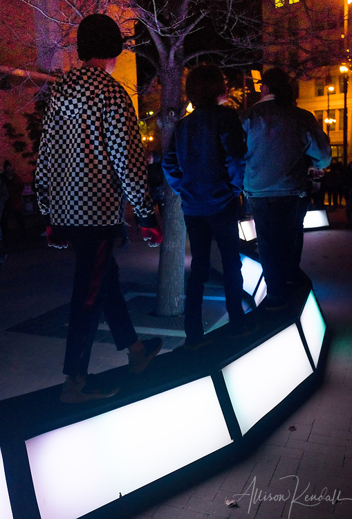 Scenes of participants and art installations during Nuit Blanche in downtown Winnipeg, Manitoba
