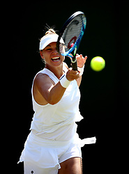 Vera Zvonareva in action against Angelique Kerber on day two of the Wimbledon Championships at the All England Lawn Tennis and Croquet Club, Wimbledon.