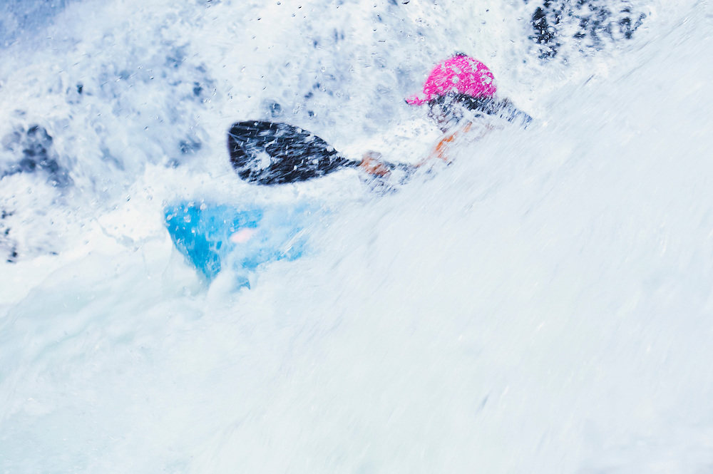 A whitewater kayaker on the Snoqualmie river, Washington, USA. Fall in the Wall.