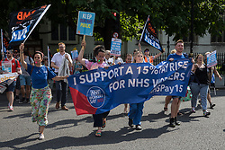 London, UK. 20th July, 2021. NHS workers from the grassroots NHSPay15 campaign march from Parliament to 10 Downing Street to present a petition signed by over 800,000 people calling for a 15% pay rise for NHS workers. At the time of presentation of the petition, the government was believed to be preparing to offer NHS workers a 3% pay rise in 'recognition of the unique impact of the pandemic on the NHS'.