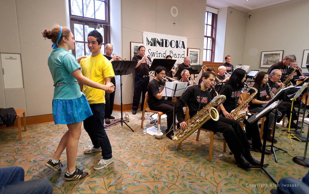 Members of the youth group Unite People dance to the music of the Minidoka Swing Band in the US Bank Room of Multnomah County Library - Central branch, Portland, Oregon. The performance was in conjunction with Portland Center Stage's production of Snow Falling on Cedars, by David Guterson.