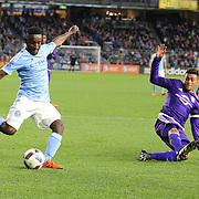 Steven Mendoza, NYCFC, hits the post with as shot as Darwin Ceren, Orlando, challenges during the New York City FC Vs Orlando City, MSL regular season football match at Yankee Stadium, The Bronx, New York,  USA. 18th March 2016. Photo Tim Clayton