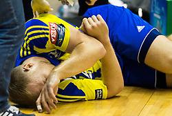 Ziga Mlakar of Celje injured during handball match between RK Celje Pivovarna Lasko (SLO) and MVM Vesprem (HUN) in Round #7 of EHF Champions League 2015/16, on November 15, 2015 in Arena Zlatorog, Celje, Slovenia. Photo by Vid Ponikvar / Sportida