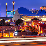 View of downtown Kansas City MO including the Kauffman Center for the Performing Arts and the Bartle Hall Skystation art implements.