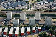 Nederland, Amsterdam, Wenkebachweg, 17-06-2008; Bijlmerbajes (Penitentiaire Inrichtingen Overamstel), met in de voorgrond studentenflats .(DUWO) aan de Wenkebachweg; achter de spoorlijn links het bedrijventerrein aan de Spaklerweg, rechts het braak liggende terrein van de de gesloopte rioolwaterzuivering; bajes, gevangenis, misdaad, strafinrichting, huis van bewaring, justitie, luchten, studenthuisvesting, Gamma, Halfords, DUWO woning .Amsterdam's main prison - jail  (in the tower flasts / blocks) and student housing (in container buildings);  .luchtfoto (toeslag); aerial photo (additional fee required); .foto Siebe Swart / photo Siebe Swart