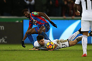 Federico Fernandez of Swansea city  is challenged by Wilfried Zaha of Crystal Palace (l).Premier league match, Swansea city v Crystal Palace at the Liberty Stadium in Swansea, South Wales on Saturday 23rd December 2017.<br /> pic by  Andrew Orchard, Andrew Orchard sports photography.