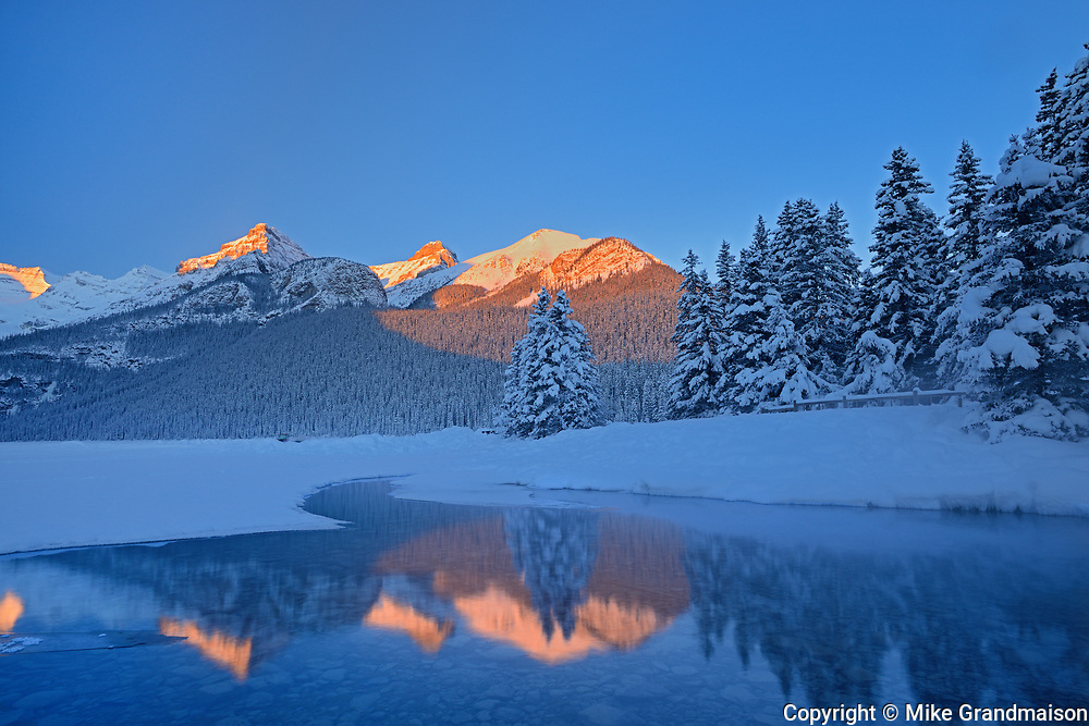 Sunrise reflection of the Canadian Rocky Mountains at Lake Louise, Banff National Park, Alberta, Canada