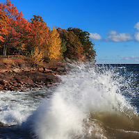 """""""Crashing Waves in Autumn""""<br /> <br /> Beautiful blue skies and water with waves crashing against the rocks of Presque Isle Park in Marquette Michigan."""