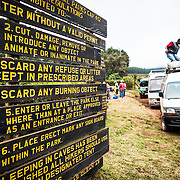 Signs and vehicles at Londorossi Gate, one of the National Park ranger gates to Kilimanjaro National Park, and the gate one must check in to when climbing the Lemosho Route of Mount Kilimanjaro.
