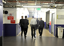© Licensed to London News Pictures. 29/09/2011. LONDON, UK. Ed Miliband (2nd L) the Leader of the Labour Party leaves the media centre after taking part in a live TV interview in a temporary studio in the conference arena at The Labour Party Conference in Liverpool today (29/09/11). Photo credit:  Stephen Simpson/LNP