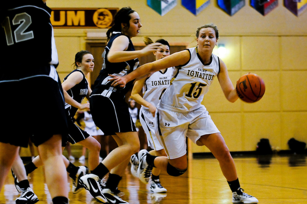 St. Ignatius Center Kelly Nickele moves past traffic during Varsity Girls Basketball vs. Mt. Assisi at the Joseph J. Gentile Gymnasium in Chicago. Ignatius delivered a decisive 53-21 victory. January 7, 2012 l Brian J. Morowczynski~ViaPhotos..For use in a single edition of Catholic New World Publications, Archdiocese of Chicago. Further use and/or distribution may be negotiated separately. ..Contact ViaPhotos at 708-602-0449 or email brian@viaphotos.com.