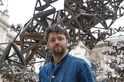© London News Pictures. 29/05/15. London, UK. The artist Conrad Shawcross stands with his new installation 'The Dappled Light of the Sun' in the Royal Academy Courtyard, Central London. Photo credit: Laura Lean/LNP
