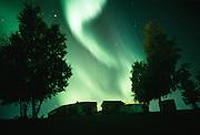Alaska. Interior. Northern lights (Aurora borealis) with structures. PR.
