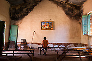 A boy stares at a painting of baby Jesus in a Catholic church in Tambura while the town was surrouned by LRA. Gun violence has become normal in post conflict South Sudan, and it will take a large effort by it's people and the government to change this.