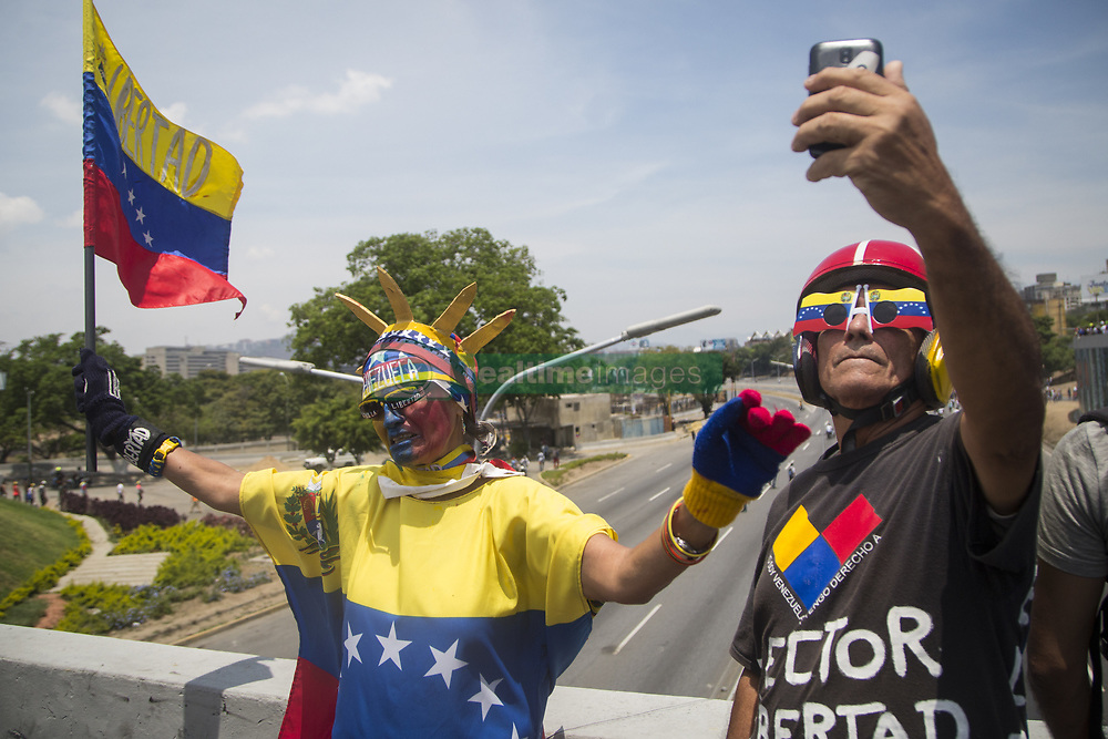 May 1, 2019 - Caracas, Venezuela - Anti-government protesters gather during clashes with security forces in the surroundings of La Carlota military base during the commemoration of May Day after a day of violent clashes on the streets of the capital. Guaido called for a massive May Day protest to increase the pressure on President Maduro. (Credit Image: © Jonathan Lanza/NurPhoto via ZUMA Press)