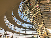 The modern Reichstag Dome interior photo. It rests atop the rebuilt Reihstag Building, the meeting place for the German Parliament, and is a symbol of reunification