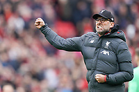 Football - 2019 / 2020 Premier League - Liverpool vs. AFC Bournemouth<br /> <br /> Liverpool manager Jürgen Klopp  fist pumps at the Kop at the end of the match, at Anfield.<br /> <br /> <br /> COLORSPORT/TERRY DONNELLY