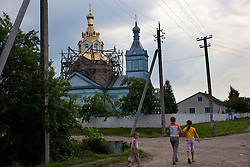 A church is seen outside of Rivne under construction in the small village of Zhovtneve, Ukraine, June 15, 2011. More than half of the worldÕs population, four billion people, live outside the rule of law, with no effective title to property, access to courts or redress for official abuse. The Open Society Justice Initiative is involved in building capacity and developing pilot programs through the use of community-based advocates and paralegals in Sierra Leone, Ukraine and Indonesia. The pilot programs, which combine education with grassroots tools to provide concrete solutions to instances of injustice, help give poor people some measure of control over their lives.