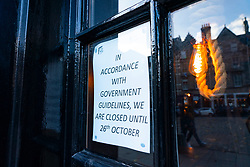 Edinburgh,Scotland, UK. 30 October 2020. With Edinburgh remaining in Tier 3 (Level 3) lockdown bars and restaurants remain severely restricted in business hours with many remaining closed and boarded up.  Pictured; The Last Drop pub remains closed. Iain Masterton/Alamy Live News
