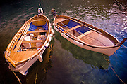 Two row boats sit in the sea at Vernazza Italy.