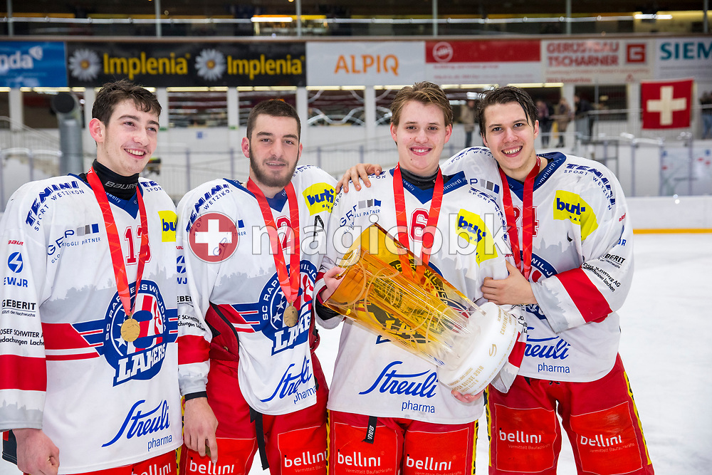 Rapperswil-Jona Lakers players Jonas Graetzer, Joel Brotzge, Micha Jud and Lars Mathis pose with the Swiss Champion trophy after winning ice hockey game 4 of the Elite B Playoff Final between EHC Chur Capricorns and Rapperswil-Jona Lakers in Chur, Switzerland, Friday, March 16, 2018. (Photo by Patrick B. Kraemer / MAGICPBK)