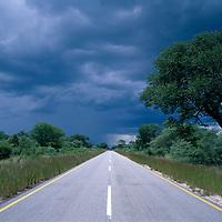 Africa, Botswana, Rainy season storm over abandoned highway north of Francistown