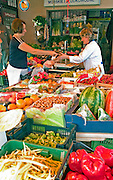 Woman age 28 purchasing fruits and vegetables at an outside sklep on Lutomierska Street Balucki District Lodz Central Poland