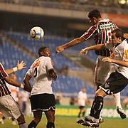 Gum of Fluminense heads his sides third goal during the  Fluminense VAtlético MG, Futebol Brasileirao  League match at Estadio Olímpico Joao Havelange, Rio de Janeiro, Fluminense won the match 5-1. Rio de Janeiro,  Brazil. 23rd September 2010. Photo Tim Clayton.