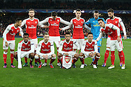 Arsenal players line up for their team photo ahead of k/o. UEFA Champions league group A match, Arsenal v Paris Saint Germain at the Emirates Stadium in London on Wednesday 23rd November 2016.<br /> pic by John Patrick Fletcher, Andrew Orchard sports photography.